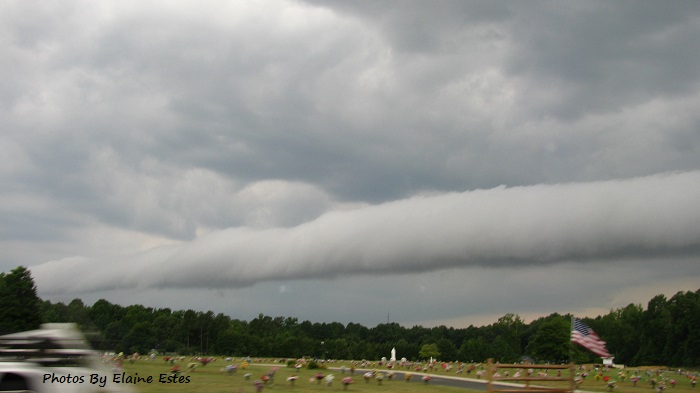 Ugly storm front coming across cemetery.