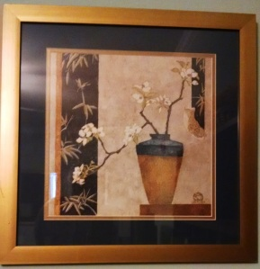 Lovely print of vase and dogwood branch.