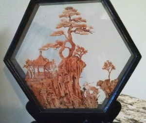 Hexagonal carved cork diorama.