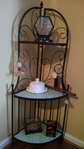Decorative Stand With Mixed Culture Items.