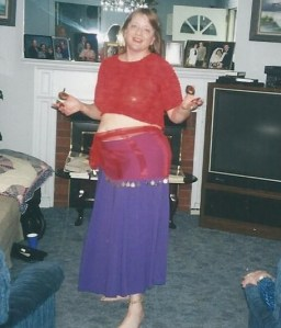 Me at 40 belly dancing for my parents with zils.