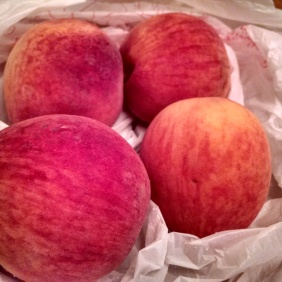 Four unpeeled SC peaches.