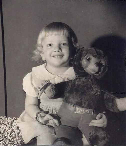Child and 1950's Smokey the Bear teddy bear