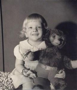 Child and 1950's Smokey the Bear teddy bear