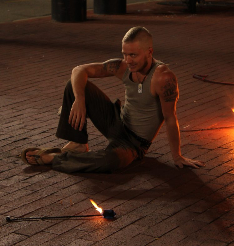 A Street Performer rests and poses.